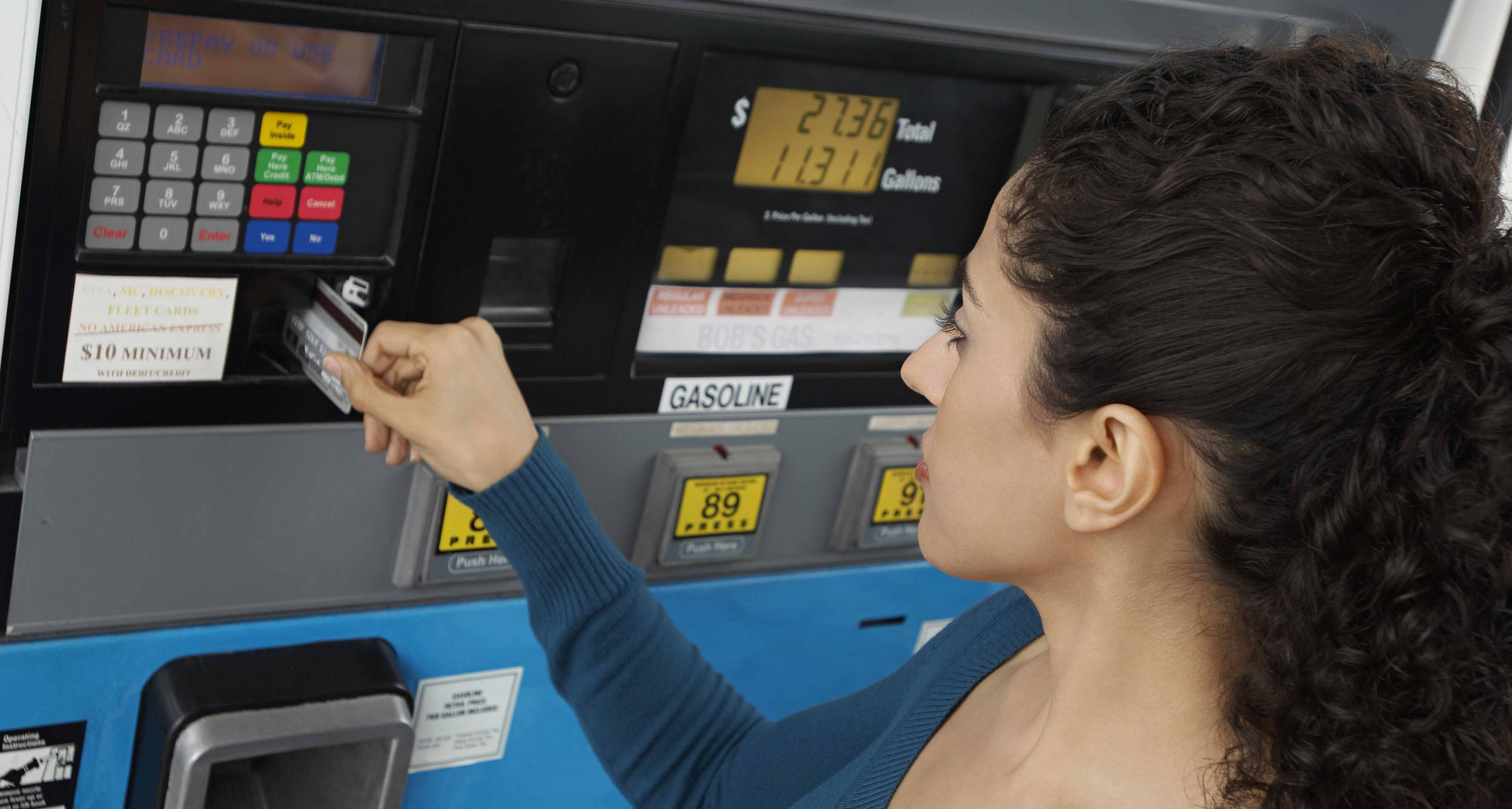 Woman-Paying-for-gas.jpg